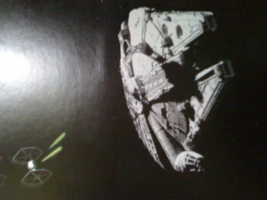 Tie Fighters attacking the Millenium Falcon