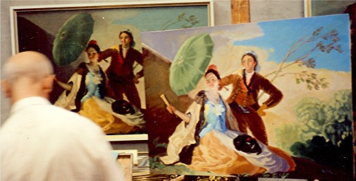 An artist inside the Prado trying to replicate Goya's painting, The Parasol, 1777