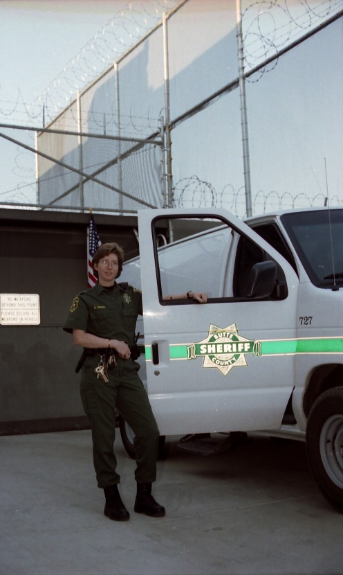 Deb hard at work for the Sheriff's department transportation unit.    copyright 2005