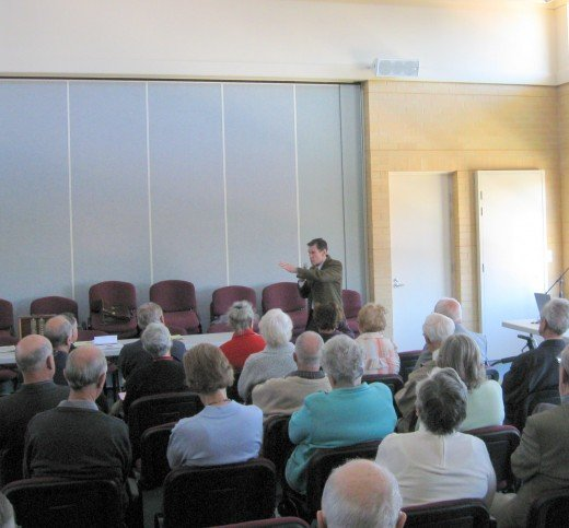 The writer presenting an entertaining story to a group of Probus members in May 2010