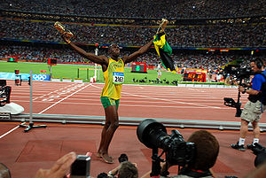 Bolt celebrates his victory and world record after the 100 m race in the Beijing National Stadium