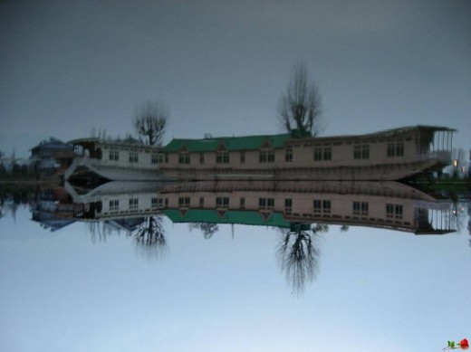 Mirror image ! : posted this picture upside down.. Can you really make it out ?? Besides the fact that the sky is lighter (below) and the water is darker (above).. This is the local boat that the villagers use. It's completely made out of wood and co