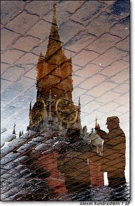 4. Red Square reflection  The Kremlin's Spassky Tower and passers-by are reflected in the wet cobblestones of Moscow's Red Square.