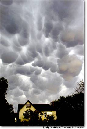 11.The gathering storm Dark clouds roll over Blair, Neb., bringing thunder and flashes of lightning.