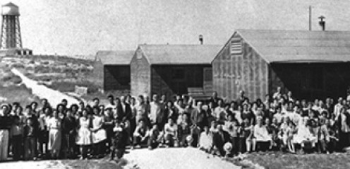 In WWII, the US rounded up not only Japanese nationals, but also naturalized US citizens of Japanese origin and their US-born children. For some reason we didn't do the same for German-Americans, though.... Image courtesy Wikimedia Commons.