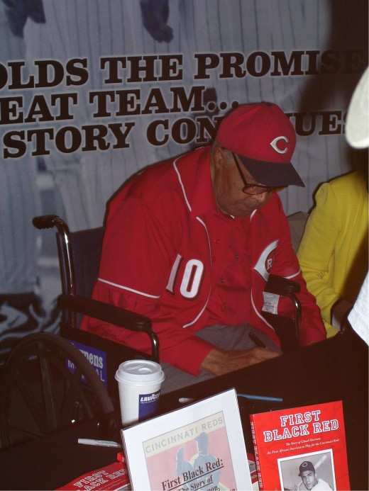 Chuck signing the book.