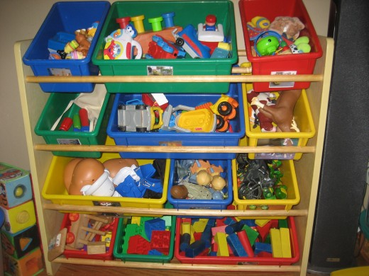 Toy storage solution - toy bin organizer - the bins on this unit have photos on the front of the toys that belong in each bin!