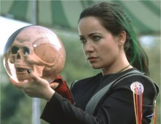 Jeneane Garofalo as The Bowler holding her clear skull bowling ball in Mystery Men