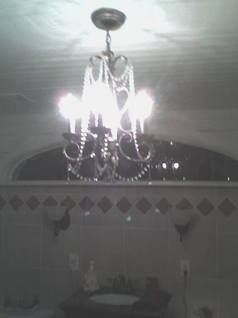 Lovely small chandelier in the new bathroom where the old side porch used to be.