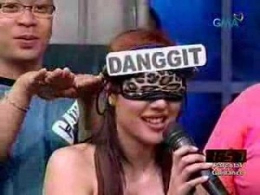 """Photo is taken from a game segment of a popular Philippine TV noontime show Eat Bulaga. The word to be guessed here is a variety of fish called """"danggit"""". The show is now using digital display in place of hard papers."""