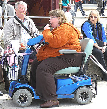 This scooter needs an additional team of four shire horses (out of shot) to pull the lady along