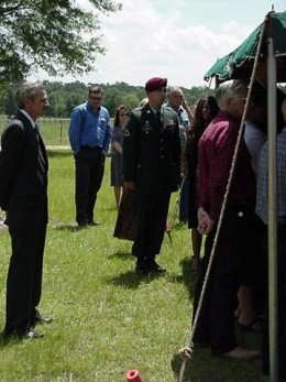 Christopher Grimet standing at attention at uncle's funeral.