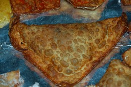 Have too much meat mixture left over? Start making full sized Empanadas! Use a full egg roll shell!