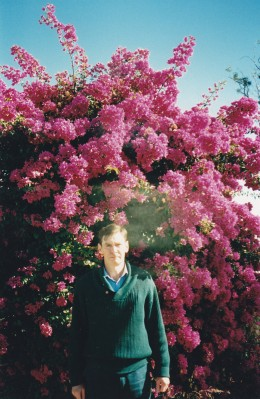 The author against a background of Bougainvillea in Queensland, Australia in 1995