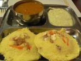 Idlies served with coconut chutney and sambar