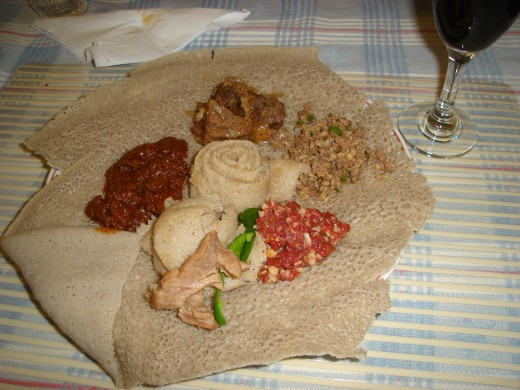 Injera with wots, and other meat dishes photo by lelanew55