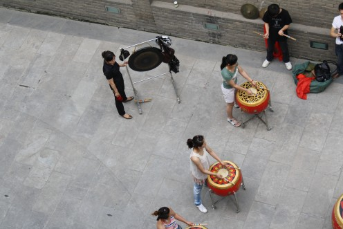 Drum practice at the base of the wall.