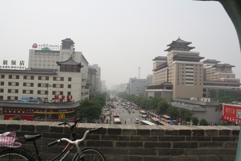 The city streets below the wall
