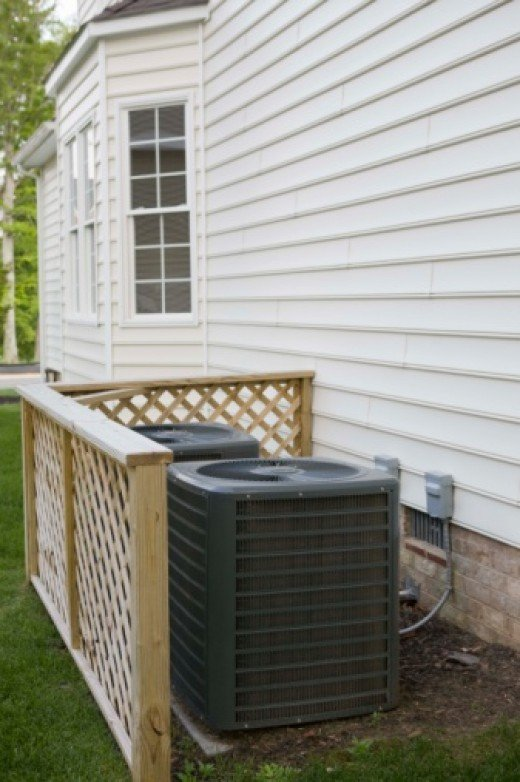 A central air conditioning unit located outside a house. Central Air conditioning provides an consistent temperature within your home
