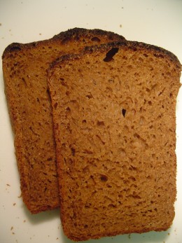 Borodinsky bread has moist dark brown slices that get soft as they are toasted.