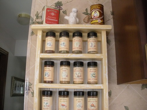 One of my spice racks, this rack was given to me by my mother a few years ago when we moved into the house.  Notice all the Watkins spices, and the neat old cinmamon tin on top.