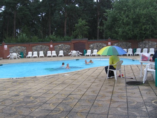 The outdoor heated swimming pool - obviously raining that day, but look - there are people in there anyway!