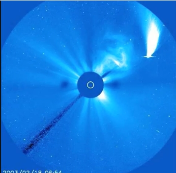 immense solar flare lashing out towards the comet, turning it away from the sun!!