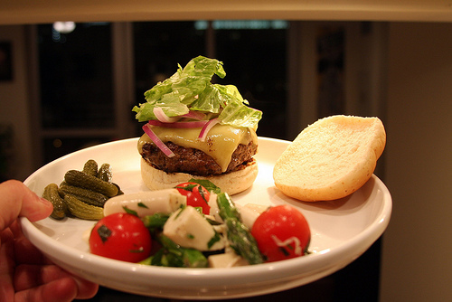 Bison burger with palm heart salad and pickles.  Photo by Joe Marinaro.