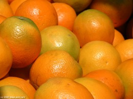 Real oranges are yellow orange and green in color.