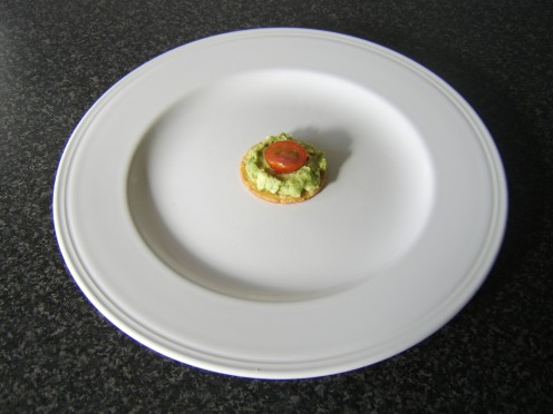 Guacamole and Tomato on a Cracker