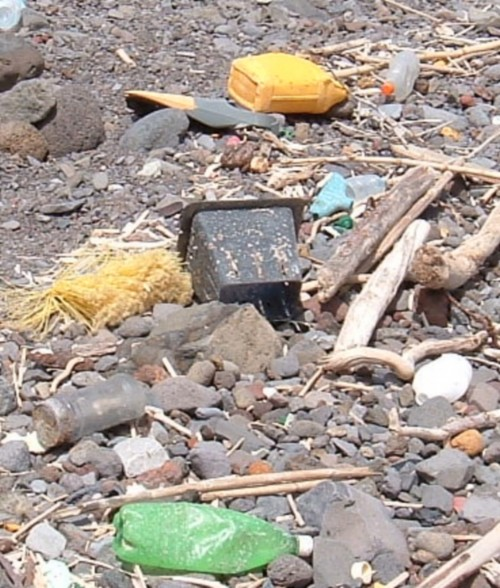 Assorted plastic items on a beach