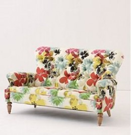 The crisp floral linen on this sofa definitely makes it more current, especially with the clean lines (no skirt).