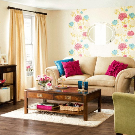 A contemporary twist in a traditional living room, accomplished with the use of supersized florals on the wall, bright pillows, neutral floors to keep it grounded.