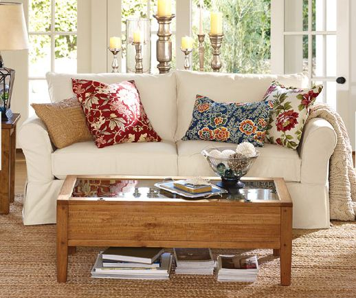 "The pillows used on this sofa don't necessary follow the ""rules"" (except they all have some off-white), but because the rest of the room is very neutral it just works and it looks beautiful and cheery."