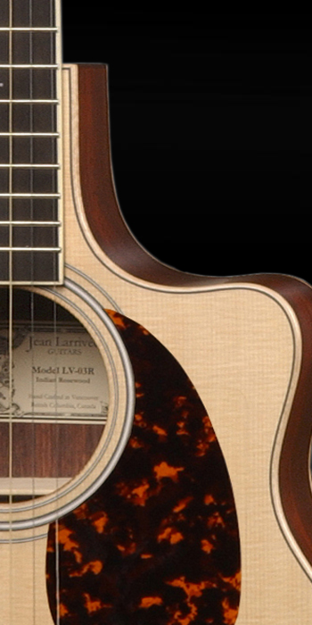 """Close up of the """"cutaway"""" feature on a guitar"""