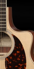 "Close up of the ""cutaway"" feature on a guitar"