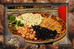 A colorful variety of beans on a designer African platter