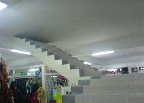 This is another funny image of what seems to be either a bad, incomplete, or poorly planned construction job. In any case this angular stairwell does not go to heaven. It simply doesn't go anywhere.