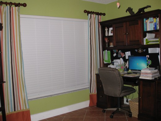 I know, it's not a kitchen, but since I mentioned my new curtains above, I thought I'd include a photo of them...my shower-curtain-turned-decorative-curtain-panels proudly hanging in my office (I'm probably sitting in that chair right now!)