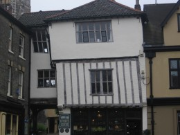 Old, leaning house at Tombland, opposite the Cathedral entrance - now an antique shop