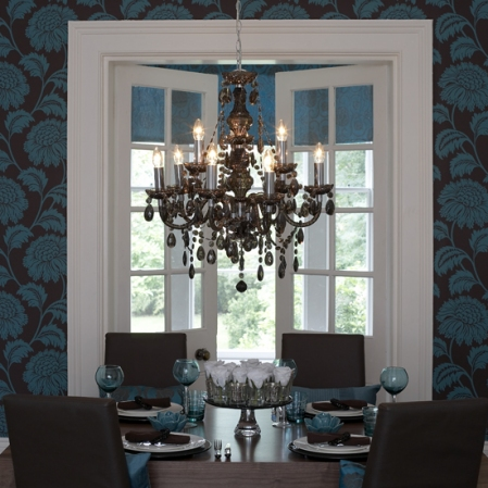 Example of table settings picking up color cues from wall color.  Also, create different moods with chandelier - change or remove shades for a different look.