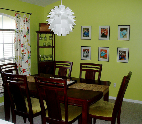 This colorful dining room was decorated on a budget, yet looks just lovely.