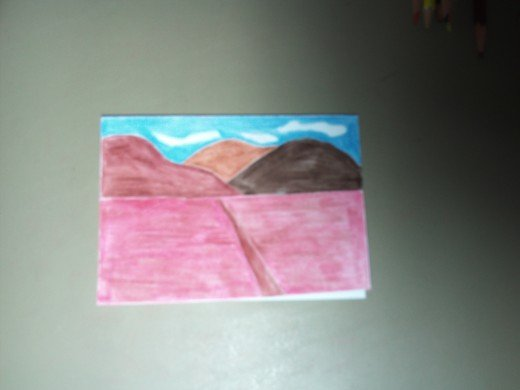 Card with a mountain landscape.