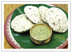 POUR CHUTNEY OVER BANANA LEAF FROM THE COPPER CONTAINER THE BANANA LEAF CONTAINS HERBS TO REDUCE BLOOD PRESSURE AND TRIGLYCERIDES.USE HAND BREAK IDLI DIP IN CHUTNEY AND EAT.TAKE A SPOON OF SAMBHAR AND SUCK IT IN TO YOUR MOUTH AS YOU MUNCH SOFT IDLI Y