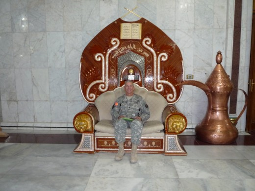 My husband Mark in the Al Faw Palace - one of Saddam's old palaces and that is one of his thrones as well my husband is sitting in.