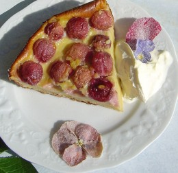 Clafouti decorated with sugared flowers.