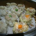 SIOMAI is made from ground pork or beef or shrimp and green peas, carrots, etc. and wrapped in wonton wrappers.  It's stemmed or fried resulting in a crispy exterior.  To eat- dip it in calamondin or calamansi juice or with spicy garlic mix
