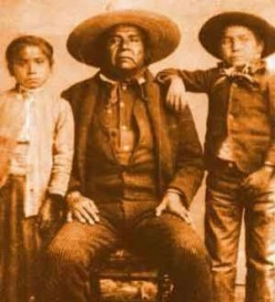 A public domain photo believed to be CHief Cochise and two native children.