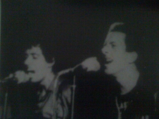 Mick Jones (left) and Joe Strummer (right)
