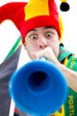 Blowing a vuvuzela